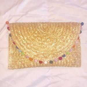 Handbags - Straw pom Pom clutch